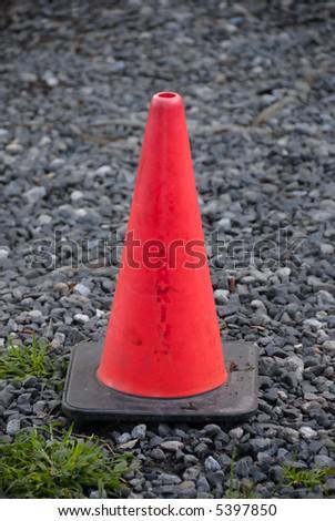 Orange road block isolated on stone back ground - stock photo