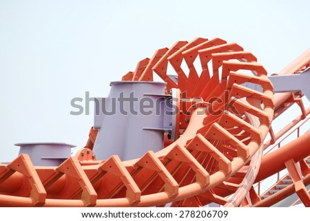 Orange roller coaster rail - stock photo