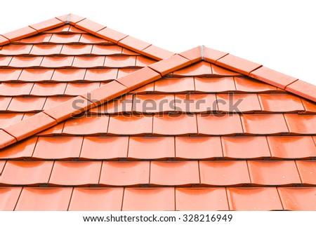 Orange roof tiles isolated on white background - stock photo