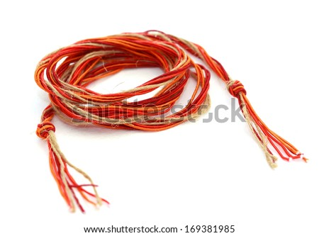 orange rope with tassels on a white background - stock photo