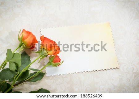 Orange roses on the table card for congratulations