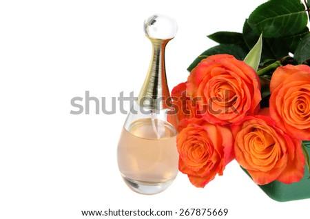 Orange roses  with parfume bottle isolated on white background  - stock photo