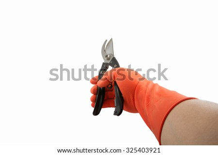 orange rubber glove and shears isolated on white background