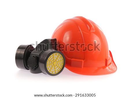 Orange safety helmet and chemical protective mask isolated on white background - stock photo