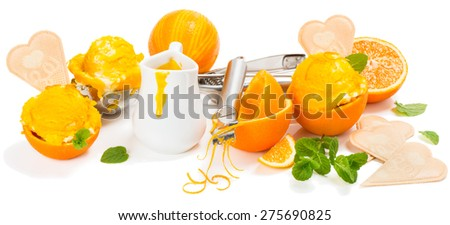 Orange  sauce, ice cream in a rinds and in a spoon for ice cream, isolated on white background - stock photo