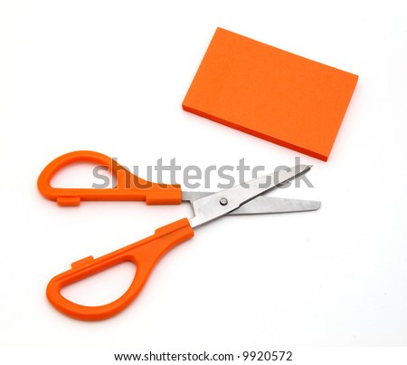 orange scissors and adhesive note on a white surface - stock photo
