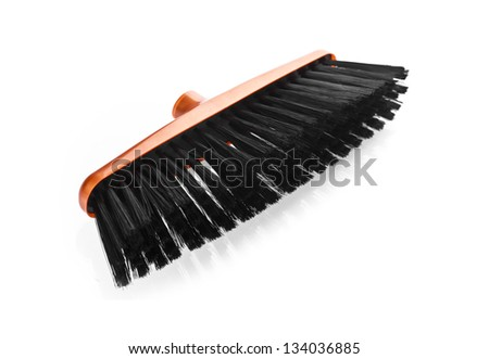 Orange  scrubbing broom on white background - stock photo