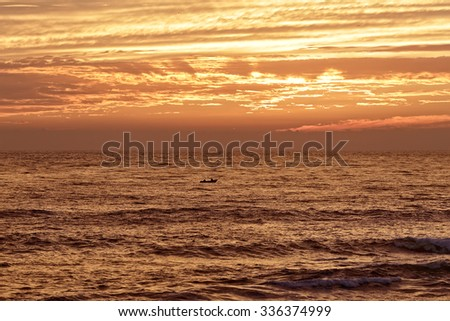 Orange seascape with beautiful cloudy sky after sunset. Autumn. North of Portugal. - stock photo