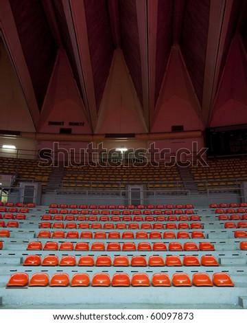 orange seat in stadium - stock photo