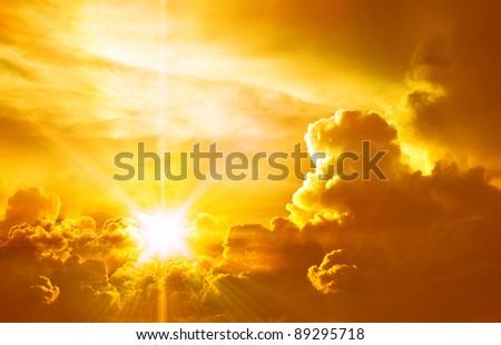 Orange sky and dramatic sunbeams - stock photo