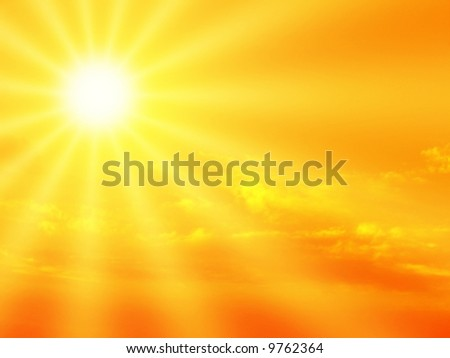 Orange sky and dramatic sunbeams - stock photo