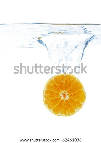Orange slice dropped in water, isolated on white - stock photo
