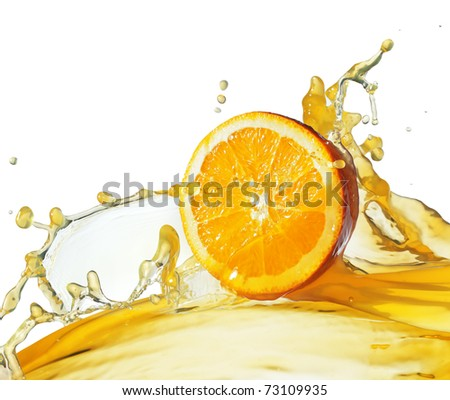 orange slice in juice stream - stock photo