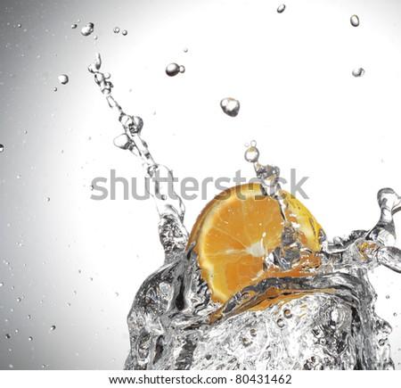 orange slice in water splash - stock photo
