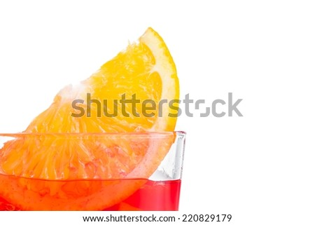 orange slice on top of the red cocktail with ice cubes on white background, with space for text - stock photo