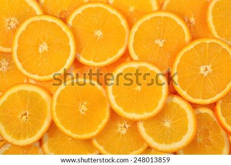Orange slices as background texture - stock photo