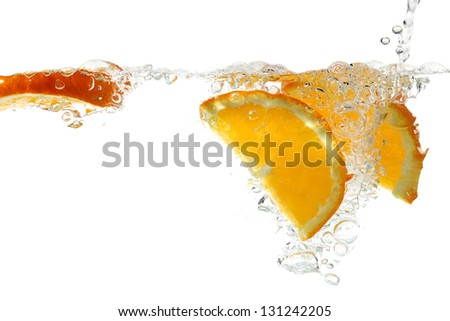 orange slices in water isolated on white - stock photo