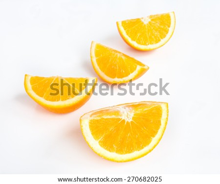 Orange slices on white table surface. - stock photo