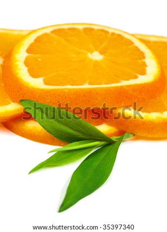 Orange slices with leaves isolated on white