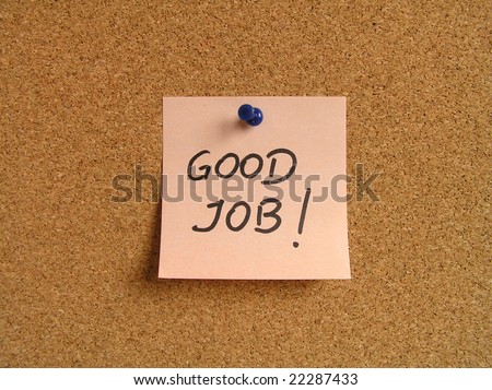 Orange small sticky note on an office cork bulletin board. Motivating and positive message.
