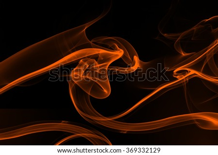 Orange smoke abstract on black background - stock photo