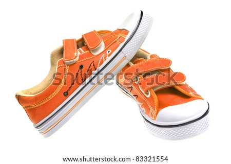 Orange sneakers isolated on white background - stock photo