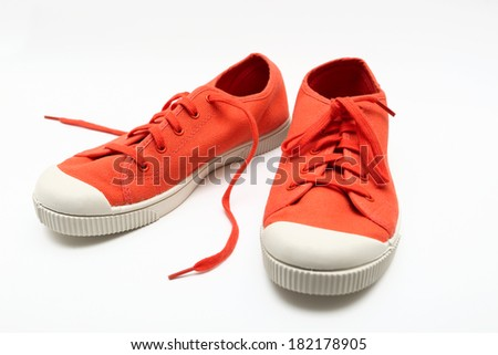 orange sneakers on a white background