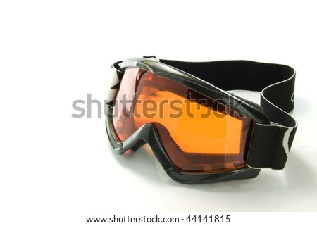 Orange snowboarding glasses on white background