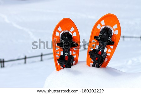Orange snowshoes for walking on the snow on the mountain in winter - stock photo