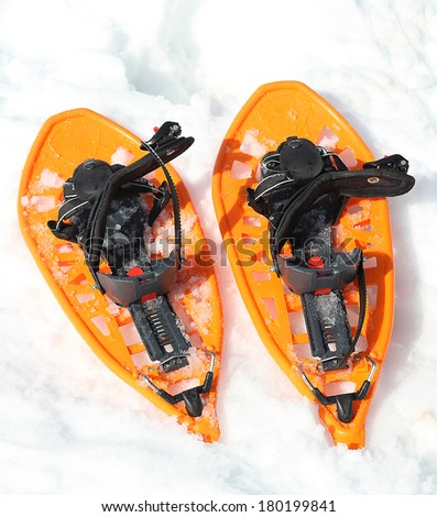 Orange snowshoes for walking on the soft snow on the high mountain in winter - stock photo