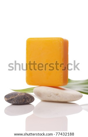 orange soap and stone on white with clipping paths - stock photo