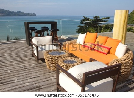 orange sofa and the colorful pillows  with the sea view in a luxury resort