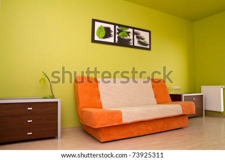 Orange sofa in modern bedroom - stock photo