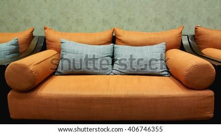 Orange sofa with gray pillows, Modern lifestyle - stock photo