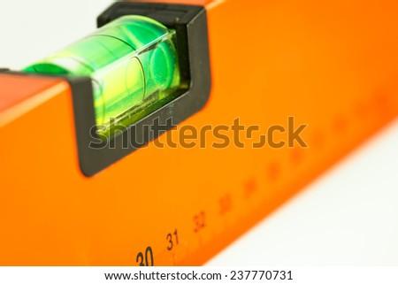 orange spirit level on white background - stock photo