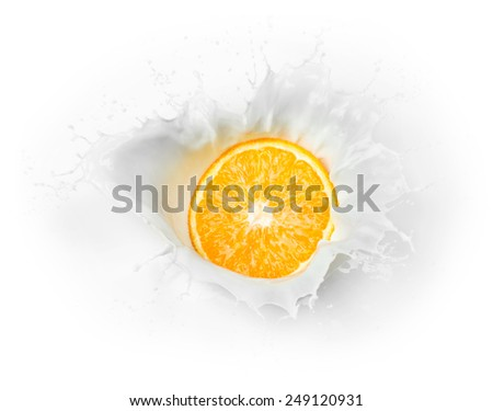 orange splashes into milk - stock photo