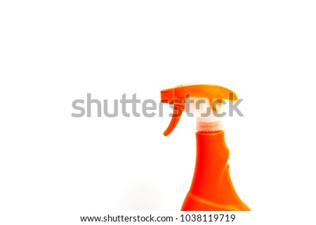 Orange  spray bottle isolated on white background