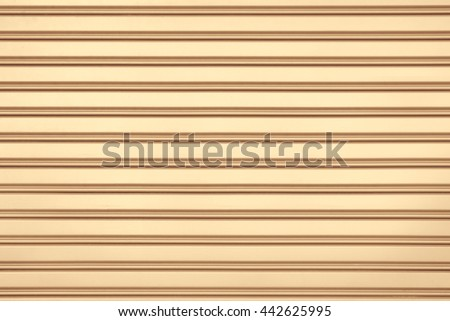Orange steel door with horizontal lines background. - stock photo