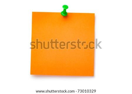 Orange sticker on green thumbtack. Isolated on white. - stock photo