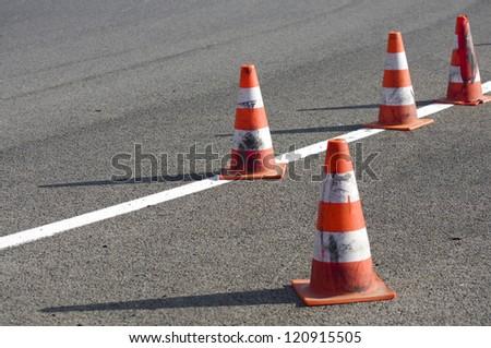 orange striped cones on the motorbike track, motoGP - stock photo