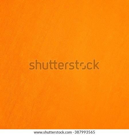 orange striped fabric as background - stock photo