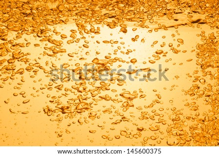 orange summer drink with bubbles - stock photo