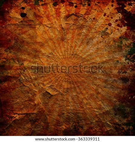 orange sun rays on a grunge background - stock photo