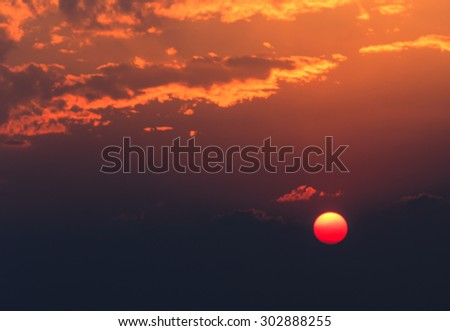 Orange sunset and cloud in evening - stock photo