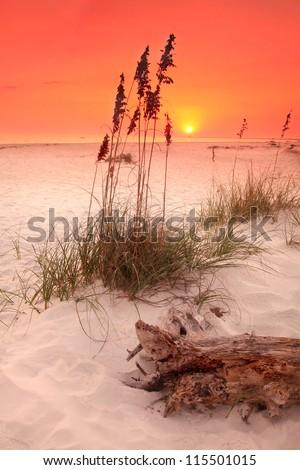 Orange Sunset on White Sand Beach - stock photo