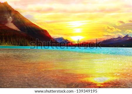 Orange sunset over Emerald lake in Canadian Rocky Mountains (Yoho National park. Alberta. Canada) - stock photo