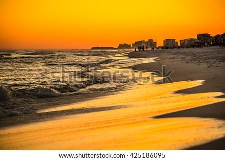 orange sunset over gulf of mexico at destin fl - stock photo