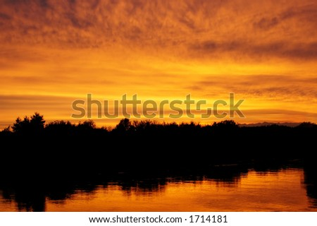 Orange sunset over river