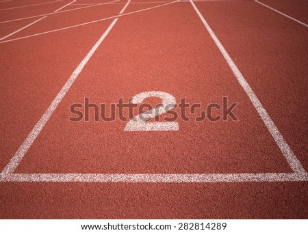 orange synthetic running track number 2 - stock photo