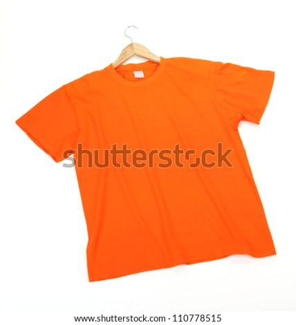 Orange t-shirt on hanger isolated on white - stock photo